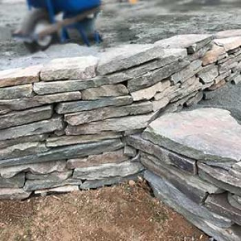 curved stone walls meet